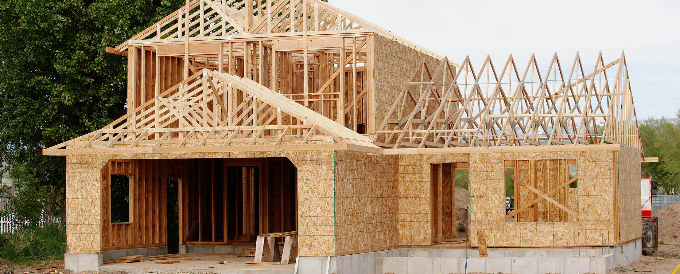 Rafters and lumber framing of a new home during the construction process